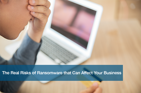 A person is affected by ransomware and is angrily looking at their credit card.