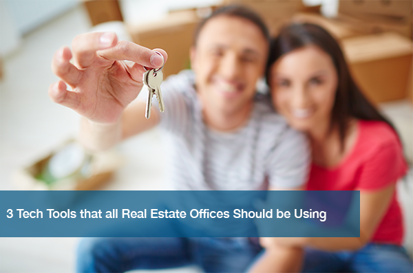 A couple holds keys to their new home from their real estate agent.