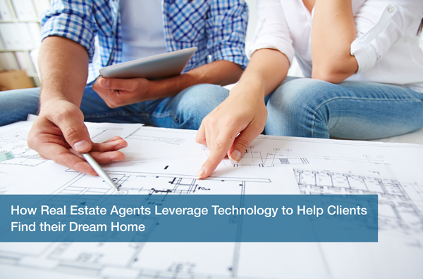 Two real estate agents look at a blueprint.