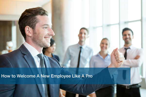 A team of employees welcoming a new employee