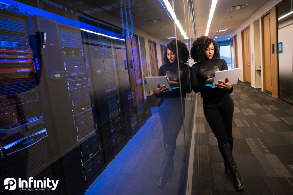 woman in hallway in data center